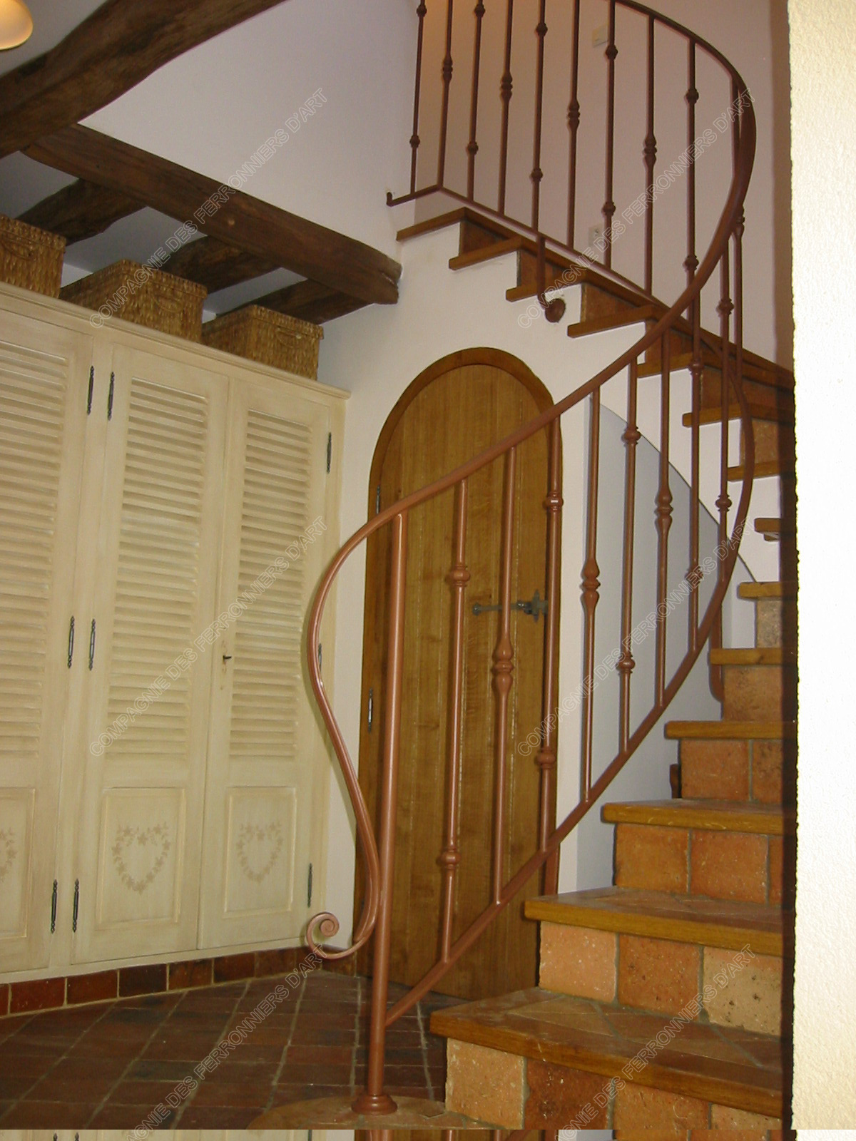 Rampes d 39 escalier en fer forg design fonctionnel mod le for Rampe d escalier lapeyre